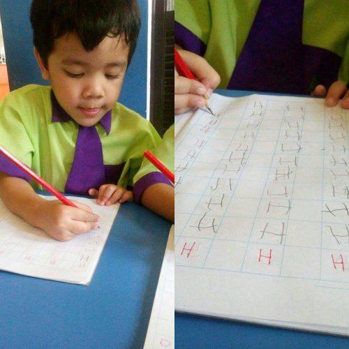 Khair belajar menulis